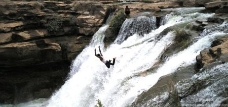 Man Jumping Over at Jamjir Water Fall at Jamvala Gir, Junagadh Cover2 Blog